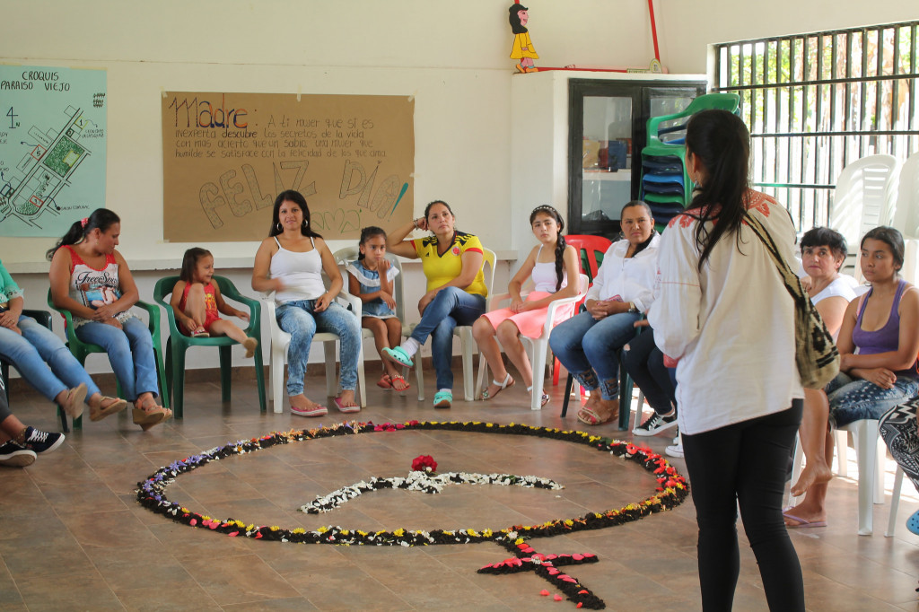 Erica Tinoco, facilitator from Casa de la Memoria, leads a women's circle