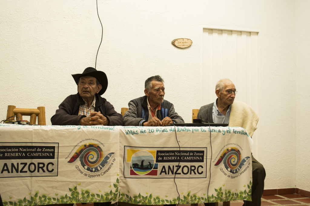 Three men from ANZORC holding a press conference