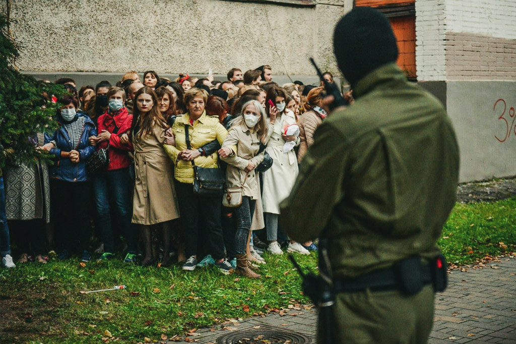 Women shielding protestors from the police in Belarus.