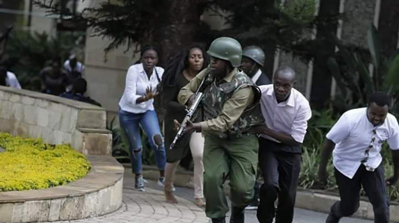 People scampering for safety during the attack. Photo by African Uncensored