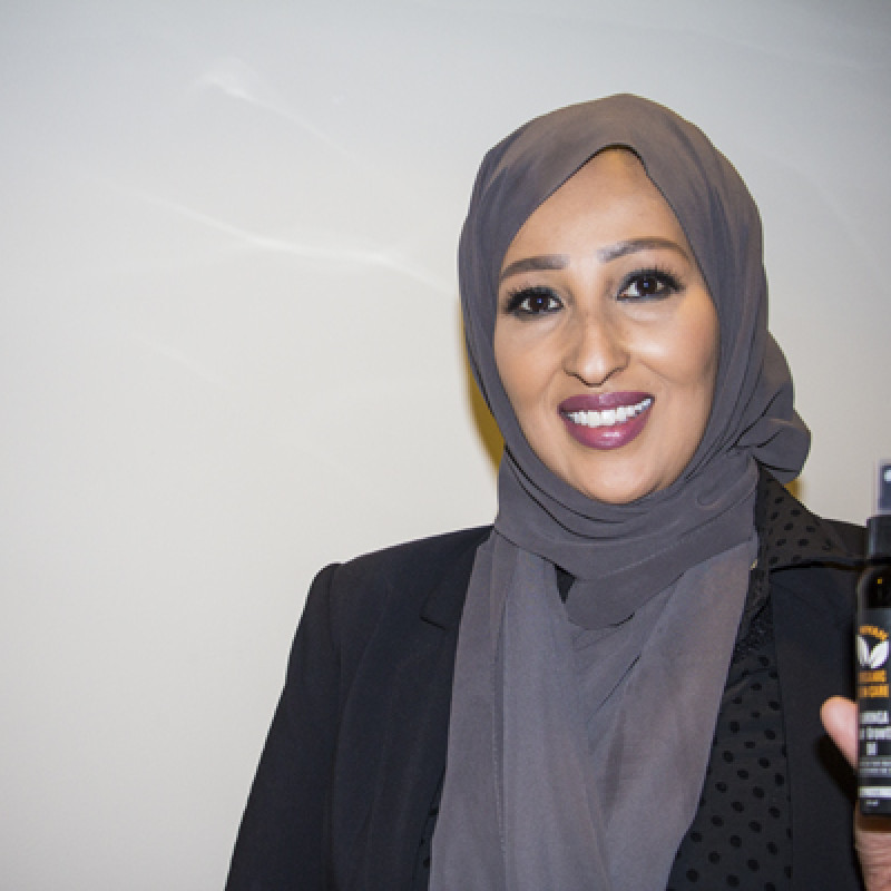 Muna Magan holding her new product.
